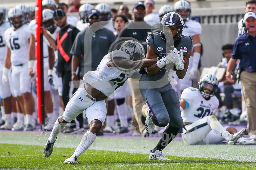 Holy Cross Crusaders wide receiver Martin Dorsey (84) Monmouth Hawks defensive back Kamau Dumas (24)