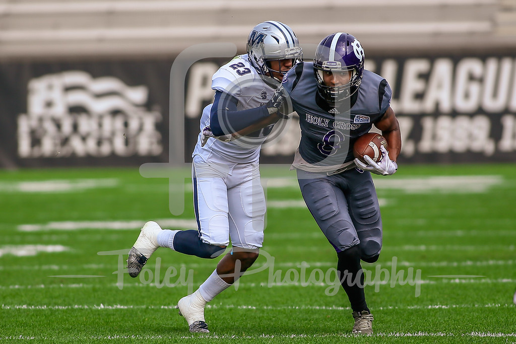 Holy Cross Crusaders wide receiver Tenio Ayeni (8) Monmouth Hawks defensive back Teddie Martinez (23)