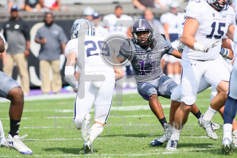 Monmouth Hawks wide receiver Matt Castronuova (29) Holy Cross Crusaders defensive back Josh Hicks (11)