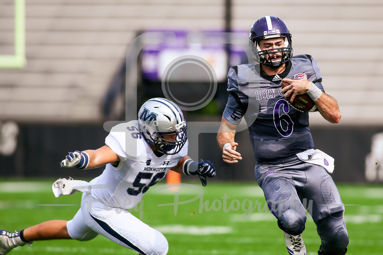 Holy Cross Crusaders quarterback Peter Pujals (6) Monmouth Hawks linebacker Diego Zubieta (56)