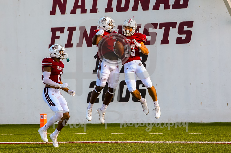 Massachusetts Minutemen wide receiver Andy Isabella (23) Massachusetts Minutemen wide receiver Jessie Britt (5)