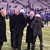 John Mara, owner of the giants and Jerry Jones, owner of the cowboys  meet onfield during pre-game warmups.