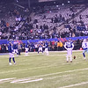 Odell watches the Dallas kicker warm up.