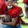 Enterprise/CHRIS GOODENOW<br /> King's High School running back Spencer Clark charges through teammates during practice, Tuesday, August 31, 2004 at Woolsey Stadium.