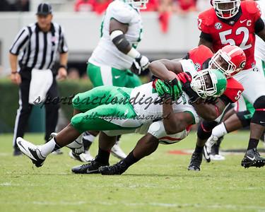 Georgia Bulldogs linebacker Jordan Jenkins (59), North Texas Mean Green running back Reggie Pegram (2)