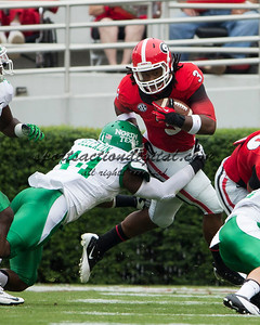Georgia Bulldogs running back Todd Gurley (3), North Texas Mean Green defensive end Aaron Bellazin (44)