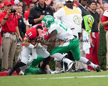 Georgia Bulldogs quarterback Aaron Murray (11), North Texas Mean Green linebacker Will Wright (11)