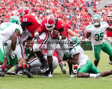 Georgia Bulldogs running back Todd Gurley (3), North Texas Mean Green defensive back Marcus Trice (8)