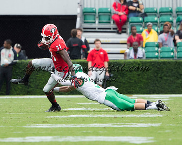 Georgia Bulldogs wide receiver Chris Conley (31), North Texas Mean Green defensive back Kenny Buyers (31)