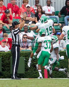 North Texas players celebrate a touchdown.