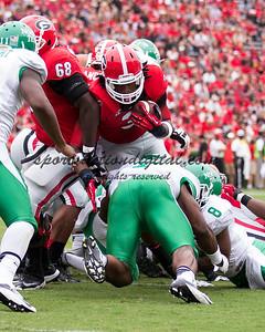 Georgia Bulldogs running back Todd Gurley (3), North Texas Mean Green linebacker Derek Akunne (7)