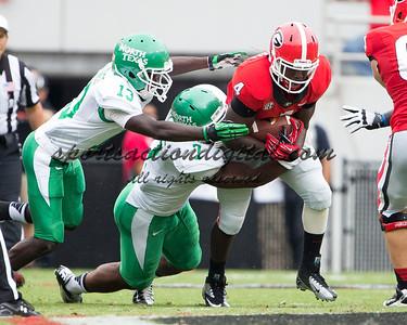 Georgia Bulldogs cornerback Damian Swann (5), North Texas Mean Green linebacker Derek Akunne (7), North Texas Mean Green defensive back James Jones (13)
