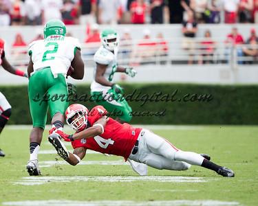 Georgia Bulldogs cornerback Brendan Langley (4), North Texas Mean Green running back Reggie Pegram (2)