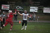 McComb's Tanner Schroeder completes a pass before PG's Gage Hovest (62) could get to him.