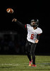 Fostoria's Dominque Settles (6) completes a pass to Avondre Reed (3) against Elmwood.