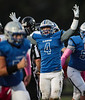 Elmwood's Sanford Fraley (4) signals touch down after hitting paydirt first against Fostoria putting the Royals on the board with five minutes remaining in the first quarter.
