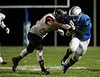 Elmwood's Josh Condon (6) is tackled by Fostoria's Keshawn Carter Stokes after catching a pass.