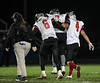 Fostoria's Dominque Settles (6) and Xavier Diaz (4) help Bryan Stenson (middle) off the field after he experienced a game ending leg injury against Elmwood.