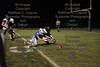 HN' Brandon Henicle (33) and Riverdale's spencer Dodds (11) both dive for the ball in the endzone. HN stopped the Riverdale drive but came up short on the ensuing possession.