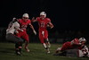 PH's Kolton Holloway (11) turns upfield following his blockers Wil Morrow (45) on LC's Alex Righi (27) and PH's Spencer Gerschutz (50) on LC's Connor Keller (19).