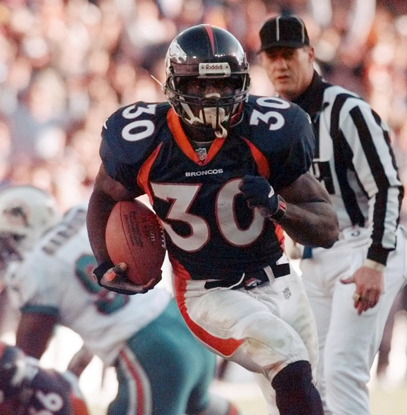 In this Jan. 9, 1999, file photo, Denver Broncos running back Terrell Davis breaks into the end zone on a 20-yard touchdown run against the Miami Dolphins during an NFL football game in Denver. Davis is part of seven-man class heading into the Pro Football Hall of Fame, it was announced Saturday, Feb. 4, 2017. (AP Photo/Bob Galbraith) - (From Georgia Sports Communiation)