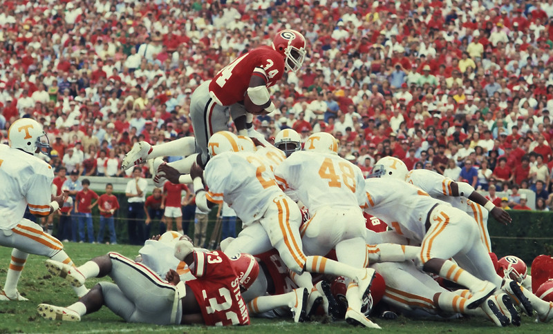 Herschel Walker caught at the high point of one of his patented goal-line leaps Photo: Georgia Sports Communications