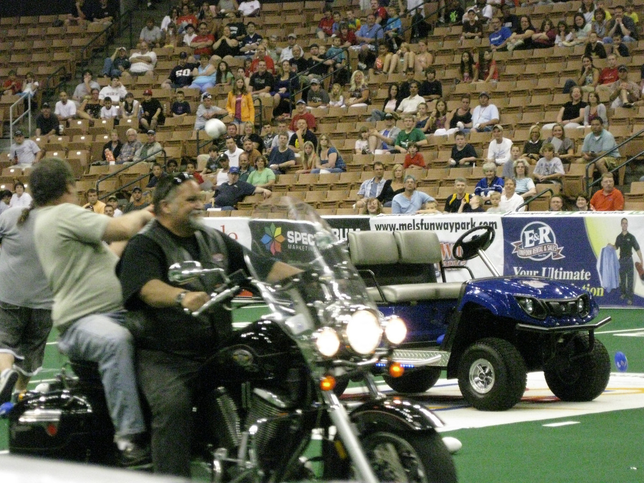 A promotion contest involving motorcycle drive-by football tossing skills.
