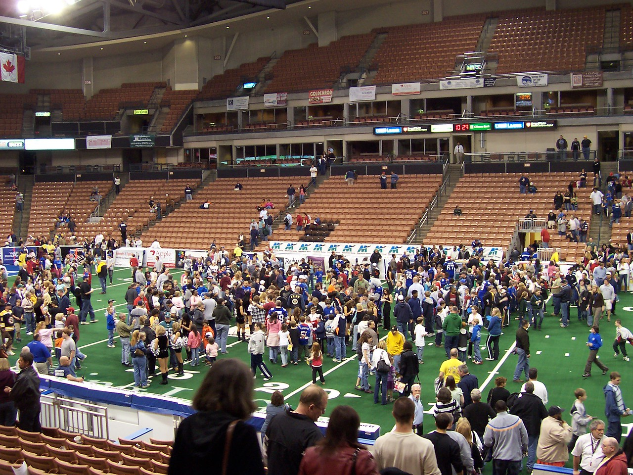 Fans on the field for the post-game photo and autograph session.