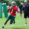 Geno Smith being watched by Marty Mornhinweg, Jets Offensive Coordinator