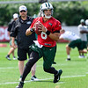 Mark Sanchez being watched by Marty Mornhinweg, Jets Offensive Coordinator