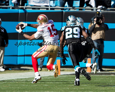 San Francisco 49ers wide receiver Michael Crabtree (15), Carolina Panthers cornerback Drayton Florence (29)
