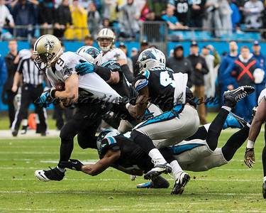 New Orleans Saints quarterback Drew Brees (9), Carolina Panthers cornerback Captain Munnerlyn (41) and Carolina Panthers defensive end Greg Hardy (76)