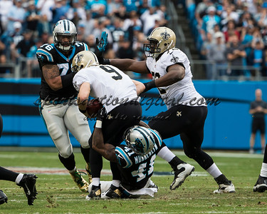 New Orleans Saints quarterback Drew Brees (9) is sacked by Carolina Panthers cornerback Captain Munnerlyn (41).