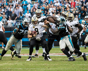 New Orleans Saints quarterback Drew Brees (9), Carolina Panthers defensive end Mario Addison (97) and Carolina Panthers defensive end Greg Hardy (76)
