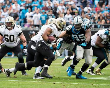 New Orleans Saints running back Mark Ingram (22), Carolina Panthers defensive end Charles Johnson (95)