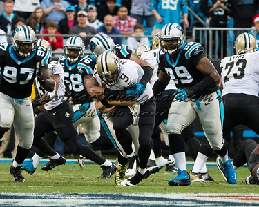 New Orleans Saints quarterback Drew Brees (9), Carolina Panthers defensive end Greg Hardy (76)