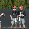 Stetson Bennett (13) and Jake Fromm (11) watch John Seter as James Coley instructs