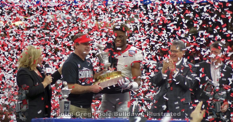 Kirby Smart and George Pickens hold the 2020 Sugar Bowl Trophy