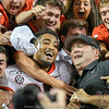Brian Herrien (35) and Kirby Smart celebrate with fans