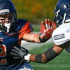 OCC WR, Joey Cox, denies Fullerton's DB, Tim Gordon, access to the football during the game in Costa Mesa, CA on 11/5/2016 at LaBard Stadium between Orange Coast College and Cal State Fullerton.<br /> <br /> Photos by Debbi Conon, Sports Shooter Academy