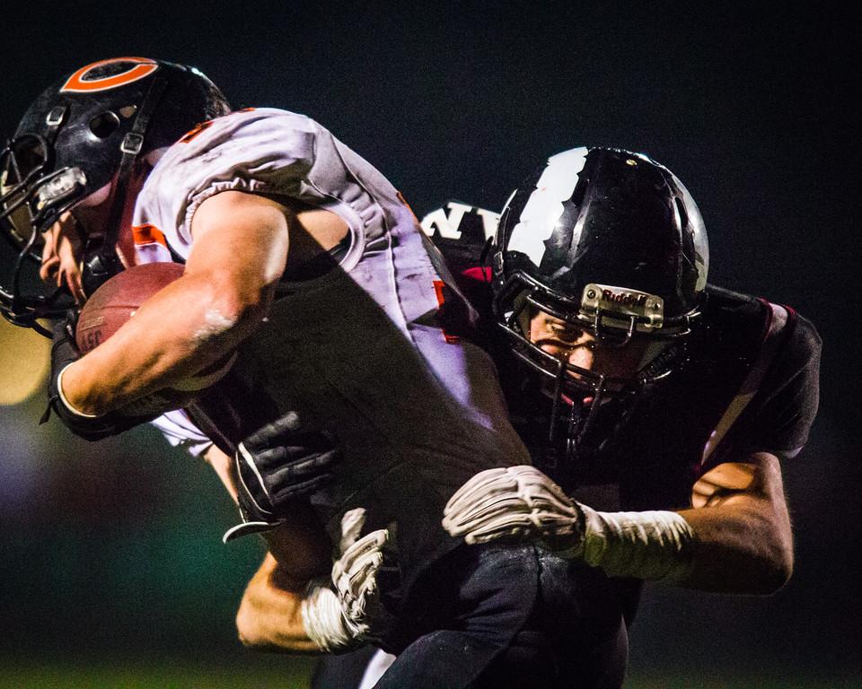 Joe Doran(21) WR/LB, Senior, tackles a Carroll player during the 2014.10.24 Carroll vs Greene County High School Football