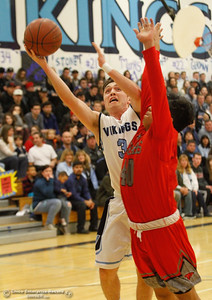 Pleasant Valley's Kyle Zelenski looks to the lay-up ad Foothill's Jonny Cruz tries to block him during a boys basketball game January 24, 2017 in Chico, California.  (Emily Bertolino -- Enterprise-Record)