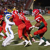 Lindsay Cardinal Jason Hernandez (6) follows the blocks of Mark Sanchez (77) and Ethan Duran (28) in their season opening contest against the Exeter Monarchs. Exeter used a hurry up offense and a swarming defense to defeat the Cardinals by a 42-14 score.