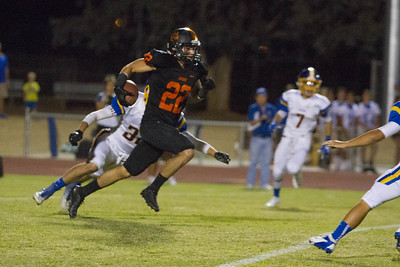 Exeter went to 2-0 with a 26-13 win over the Woodlake Tigers. Woodlake WR Andrew Chavez races up field against the Monarchs.