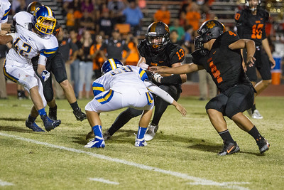Exeter went to 2-0 with a 26-13 win over the Woodlake Tigers. Exeter Monarch DB Dalton Padilla (20) tackles Woodlake Tiger RB Alex Marquez (13).