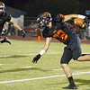 Woodlake cruised to a 55-27 victory over the visiting Farmersville Aztecs. Woodlake WR/RB Andrew Chavez (22) escapes the tackle of Anthony Castillo (3).