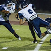 Woodlake cruised to a 55-27 victory over the visiting Farmersville Aztecs. Aztec defenders Sylvester Hernandez (52), Skylar Morris (6) converge on the Woodlake ball carrier.