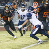 Woodlake cruised to a 55-27 victory over the visiting Farmersville Aztecs. Woodlake RB Alex Marquez (13) look to rush up field against the Farmersville Aztec defenders.
