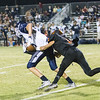 Woodlake cruised to a 55-27 victory over the visiting Farmersville Aztecs. Woodlake DB Henry Hagen (7) attempts to bring down Aztec wide out Skylar Morris (6) after a completion by Farmersville.