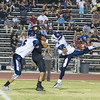 Woodlake cruised to a 55-27 victory over the visiting Farmersville Aztecs. Woodlake Tiger WR Andrew Chavez (22) catches a pass from Woodlake QB Eric Schwarz between Farmersville Aztec defenders Skylar Morris (6) and Victor Castrejon (4).